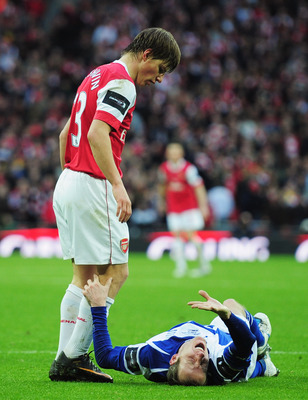 LONDON, ENGLAND - FEBRUARY 27:  Lee Bowyer of Birmingham City grimaces as Andrey Arshavin of Arsenal looks on during the Carling Cup Final between Arsenal and Birmingham City at Wembley Stadium on February 27, 2011 in London, England.  (Photo by Shaun Bot