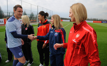 ST ALBANS, ENGLAND - MARCH 22: John Terry meets players from the Women's Super League during the England training session ahead of their UEFA EURO 2012 qualifier against Wales, at London Colney on March 22, 2011 in St Albans, England.  (Photo by Michael R