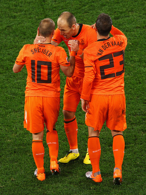 CAPE TOWN, SOUTH AFRICA - JULY 06:  Wesley Sneijder of the Netherlands celebrates scoring his side's second goal with team mates Arjen Robben and Rafael Van der Vaart during the 2010 FIFA World Cup South Africa Semi Final match between Uruguay and the Net