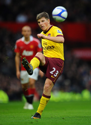 MANCHESTER, ENGLAND - MARCH 12:  Andrey Arshavin of Arsenal passes the ball during the FA Cup sponsored by E.On Sixth Round match between Manchester United and Arsenal at Old Trafford on March 12, 2011 in Manchester, England.  (Photo by Clive Mason/Getty