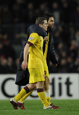 BARCELONA, SPAIN - MARCH 08:  Cesc Fabregas of Arsenal (R) consoles his team-mate Jack Wilshere of Arsenal at the end of the UEFA Champions League round of 16 second leg match between Barcelona and Arsenal at the Camp Nou stadium on March 8, 2011 in Barce