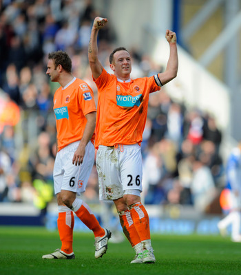 BLACKBURN, ENGLAND - MARCH 19:  Charlie Adam of Blackpool celebrates after scoring to make it 1-0 during the Barclays Premier League match between Blackburn Rovers and Blackpool at Ewood Park on March 19, 2011 in Blackburn, England.  (Photo by Michael Reg