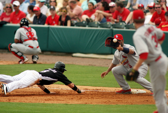 JUPITER, FL - MARCH 06: First baseman Albert Pujols #5 of the St. Louis Cardinals picks off Chris Coghlan #8 of the Florida Marlins at Roger Dean Stadium on March 6, 2011 in Jupiter, Florida.  (Photo by Marc Serota/Getty Images)