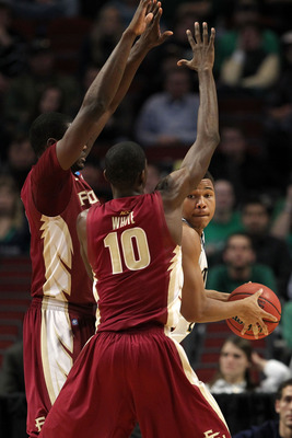 CHICAGO, IL - MARCH 20:  Tyrone Nash #1 of the Notre Dame Fighting Irish looks to pass against Okaro White #10 of the Florida State Seminoles in the second half during the third round of the 2011 NCAA men's basketball tournament at the United Center on Ma