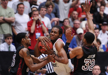 TUCSON, AZ - MARCH 19:  Ramone Moore #23 and Rahlir Jefferson #32 of the Temple Owls attempt to steal from Kawhi Leonard #15 of the San Diego State Aztecs in double overtime during the third round of the 2011 NCAA men's basketball tournament at McKale Cen