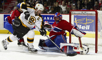 MONTREAL, CAN - APRIL 17:  Jose Theodore #60 of the Montreal Canadiens makes a pad save against Joe Thornton #19 of the Boston Bruins during game six of the Eastern Conference Quarterfinals at Bell Centre on April 17, 2004 in Montreal, Canada.  (Photo by
