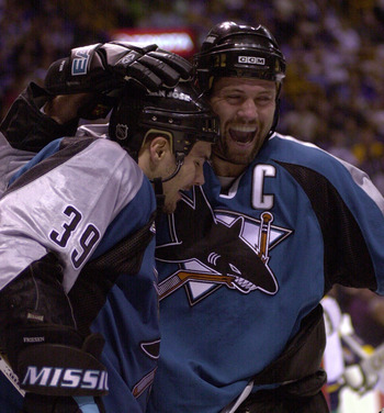 25 Apr 2000: Owen Nolan #11 congratulates Jeff Friesen #39 of the San Jose Sharks after Friesen scored the third goal for the sharks during the second period against the St. Louis Blues during the first round of the NHL Stanley Cup Playoffs at the Kiel Ce