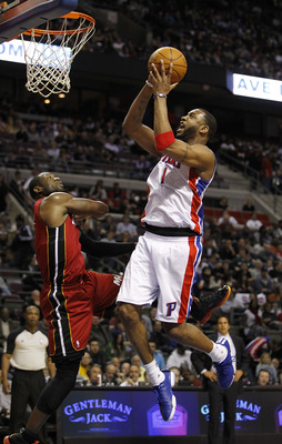 AUBURN HILLS, MI - MARCH 23:  Tracy McGrady #1 of the Detroit Pistons gets a shot off over Dwyane Wade #3 of the Miami Heat at The Palace of Auburn Hills on March 23, 2011 in Auburn Hills, Michigan. Miami won the game 100-94. NOTE TO USER: User expressly
