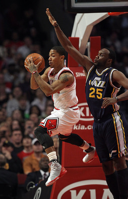 CHICAGO, IL - MARCH 12: Derrick Rose #1 of the Chicago Bulls passes the ball under pressure from Al Jefferson #25 of the Utah Jazz at the United Center on March 12, 2011 in Chicago, Illinois. The Bulls defeated the Jazz 118-100. NOTE TO USER: User express