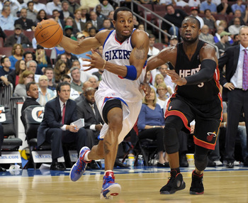PHILADELPHIA - OCTOBER 27:  Andre Iguodala #9 of the Philadelphia 76ers drives past Dwyane Wade #3 of the Miami Heat at the Wells Fargo Center on October 27, 2010 in Philadelphia, Pennsylvania. NOTE TO USER: User expressly acknowledges and agrees that, by