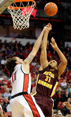 LAS VEGAS, NV - DECEMBER 30:  Jalin Thomas #31 of the Central Michigan Chippewas shoots against Carlos Lopez #11 of the UNLV Rebels during their game at the Thomas & Mack Center December 30, 2010 in Las Vegas, Nevada. UNLV won 73-47.  (Photo by Ethan Mill