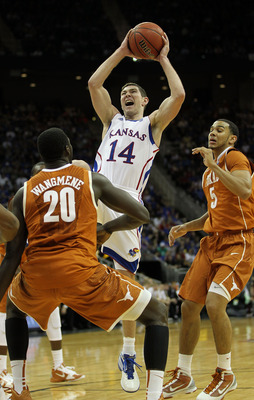 KANSAS CITY, MO - MARCH 12:  Tyrel Reed #14 of the Kansas Jayhawks goes up for a shot against the Texas Longhorns during the 2011 Phillips 66 Big 12 Men's Basketball Tournament championship game at Sprint Center on March 12, 2011 in Kansas City, Missouri.