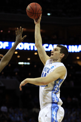 CHARLOTTE, NC - MARCH 20:  Tyler Zeller #44 of the North Carolina Tar Heels shoots over a Washington Huskies defender during the third round of the 2011 NCAA men's basketball tournament at Time Warner Cable Arena on March 20, 2011 in Charlotte, North Caro