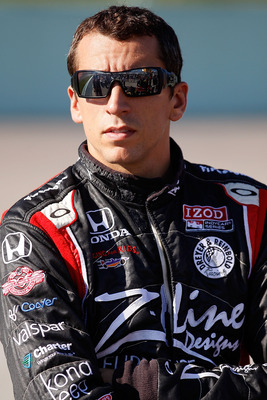HOMESTEAD, FL - OCTOBER 01:  Justin Wilson of England, driver of the #22 Team Z-Line Designs Dallara Honda stands on pit road during qualifying for the IZOD IndyCar Series Cafes do Brasil Indy 300 at Homestead-Miami Speedway on October 1, 2010 in Homestea
