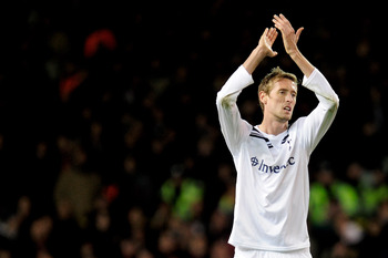 LONDON, ENGLAND - MARCH 09:  Peter Crouch of Tottenham applauds the crowd during the UEFA Champions League round of 16 second leg match between Tottenham Hotspur and AC Milan at White Hart Lane on March 9, 2011 in London, England.  (Photo by Jamie McDonal