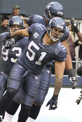 SEATTLE, WA - DECEMBER 05:  Linebacker Lofa Tatupu #51 of the Seattle Seahawks celebrates with teammates after returning an interception for a touchdown against the Carolina Panthers at Qwest Field on December 5, 2010 in Seattle, Washington. The Seahawks