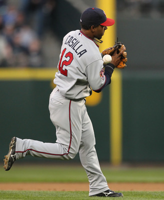 SEATTLE - AUGUST 27:  Shortstop Alexi Casilla #12 of the Minnesota Twins bobbles an infield single by Adam Moore of the Seattle Mariners at Safeco Field on August 27, 2010 in Seattle, Washington. The Twins won 6-3. (Photo by Otto Greule Jr/Getty Images)