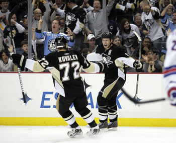 PITTSBURGH, PA - MARCH 20:  Jordan Staal #11 of the Pittsburgh Penguins celebrates his first period goal with Alexei Kovalev #72 against the New York Rangers at Consol Energy Center on March 20, 2011 in Pittsburgh, Pennsylvania.  (Photo by Justin K. Aller