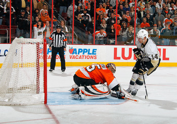 PHILADELPHIA - MARCH 24:  Chris Kunitz #14 of the Pittsburgh Penguins scoring the game winner in a shootout against the Philadelphia Flyers on March 24, 2011 at the Wells Fargo Center in Philadelphia, Pennsylvania.  (Photo by Lou Capozzola/Getty Images)