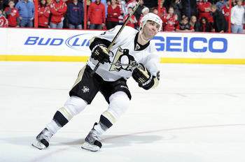 WASHINGTON, DC - DECEMBER 23:  Pascal Dupuis #9 of the Pittsburgh Penguins celebrates after scoring the game winning goal during the shootout against the Washington Capitals at the Verizon Center on December 23, 2010 in Washington DC. The Penguins won the