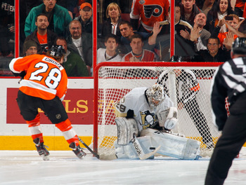 PHILADELPHIA - MARCH 24:  Marc Andre Fleury #29 of the Pittsburgh Penguins makes a save against Claude Giroux #28 of the Philadelphia Flyers during the shootout on March 24, 2011 at the Wells Fargo Center in Philadelphia, Pennsylvania.  (Photo by Lou Capo