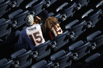 DENVER - DECEMBER 26:  Fans wearing Tim Tebow jersies begin to occupy the empty seats prior to the game as the Denver Broncos host the Houston Texas at INVESCO Field at Mile High on December 26, 2010 in Denver, Colorado. The Broncos defeated the Texans 24