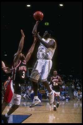 3 Dec 1996:  Guard Cameron Dollar of the UCLA Bruins (right) goes up for two as California State - Northridge Matadors guard Trenton Cross covers him during a game at Pauley Pavilion in Los Angeles, California.  UCLA won the game, 95-73. Mandatory Credit: