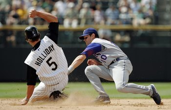 DENVER - JUNE 25:  Shortstop Michael Young #10 of the Texas Rangers tags out Matt Holliday #5 of the Colorado Rockies at second base on a fly out by Garrett Atkins in the eighth inning on June 25, 2006 at Coors Field in Denver, Colorado.  The Rockies won