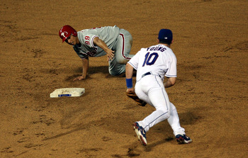 ARLINGTON, TX - JUNE 27:  So Taguchi #99 of the Philadelphia Phillies steals second base against Michael Young #10 of the Texas Rangers during Interleague MLB action on June 27, 2008 at Rangers Ballpark in Arlington, Texas.  (Photo by Ronald Martinez/Gett