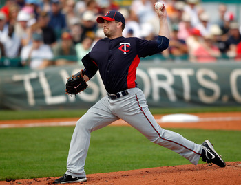 BRADENTON, FL - MARCH 02:  Pitcher Brian Duensing #52 of the Minnesota Twins pitches against the Pittsburgh Pirates during a Grapefruit League Spring Training Game at McKechnie Field on March 2, 2011 in Bradenton, Florida.  (Photo by J. Meric/Getty Images