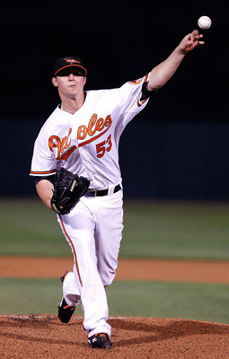 SARASOTA, FL - MARCH 07:  Pitcher Zach Britton #53 of the Baltimore Orioles pitches against the New York Yankees during a Grapefruit League Spring Training Game at Ed Smith Stadium on March 7, 2011 in Sarasota, Florida.  (Photo by J. Meric/Getty Images)