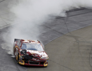 BRISTOL, TN - MARCH 20:  Clint Bowyer, driver of the #33 BB&T Chevrolet, spins out after an incident in the NASCAR Sprint Cup Series Jeff Byrd 500 Presented By Food City at Bristol Motor Speedway on March 20, 2011 in Bristol, Tennessee.  (Photo by Chris T