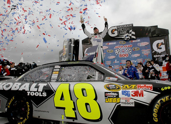 FONTANA, CA - FEBRUARY 21:  Jimmie Johnson, driver of the #48 Lowe's/Kobalt Tools Chevrolet, celebrates in victory lane after winning the NASCAR Sprint Cup Series Auto Club 500 at Auto Club Speedway on February 21, 2010 in Fontana, California.  (Photo by