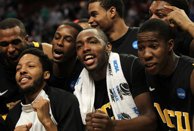 CHICAGO, IL - MARCH 20:  Ed Nixon #50, Brandon Rozzell #32 and teammates celebrate their win over the Purdue Boilermakers in the second half during the third round of the 2011 NCAA men's basketball tournament at the United Center on March 20, 2011 in Chic