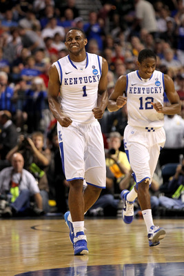 TAMPA, FL - MARCH 19:  Darius Miller #1 and Brandon Knight #12 of the Kentucky Wildcats celebrate a play against the West Virginia Mountaineers during the third round of the 2011 NCAA men's basketball tournament at St. Pete Times Forum on March 19, 2011 i