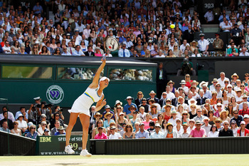 LONDON, ENGLAND - JULY 03:  Vera Zvonareva of Russia serves during the Ladies Singles Final Match against Serena Williams of USA on Day Twelve of the Wimbledon Lawn Tennis Championships at the All England Lawn Tennis and Croquet Club on July 3, 2010 in Lo