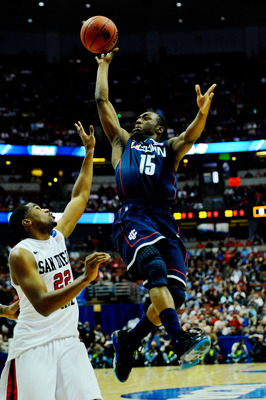 ANAHEIM, CA - MARCH 24:  Kemba Walker #15 of the Connecticut Huskies drives to the basket against Chase Tapley #22 of the San Diego State Aztecs during the west regional semifinal of the 2011 NCAA men's basketball tournament at the Honda Center on March 2