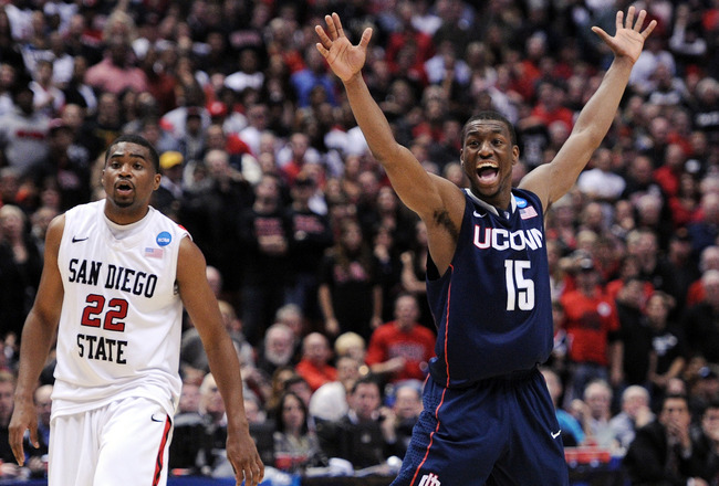 ANAHEIM, CA - MARCH 24:  Kemba Walker #15 of the Connecticut Huskies reacts after a play against Chase Tapley #22 of the San Diego State Aztecs looks on during the west regional semifinal of the 2011 NCAA men's basketball tournament at the Honda Center on