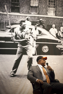 NEW YORK - JANURARY 21:  Sitting in front of a picture of himself playing stickball on the streets of Harlem, Willie Mays is interviewed at PS 46, next to the site of the former Polo Grounds, where the new York Giants played before moving to San Francisco