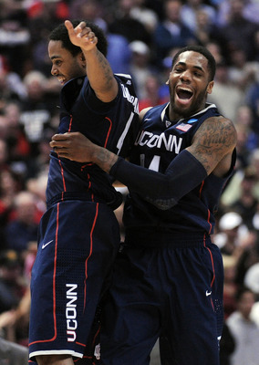 ANAHEIM, CA - MARCH 24:  Jamal Coombs-McDaniel #4 and Alex Oriakhi #34 of the Connecticut Huskies celebrate after defeating the San Diego State Aztecs during the west regional semifinal of the 2011 NCAA men's basketball tournament at the Honda Center on M