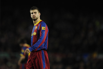 BARCELONA, SPAIN - MARCH 05:  Gerard Pique of FC Barcelona looks on during the La liga match between Barcelona and Real Zaragoza at Camp Nou on March 5, 2011 in Barcelona, Spain. Barcelona won 1-0.  (Photo by David Ramos/Getty Images)