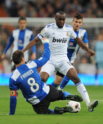 MADRID, SPAIN - MARCH 12: Lass Diarra of Real Madrid takes on ;Francisco Farinos of Hercules CF   during the La Liga match between Real Madrid and Hercules CF at Estadio Santiago Bernabeu on March 12, 2011 in Madrid, Spain.  (Photo by Denis Doyle/Getty Im