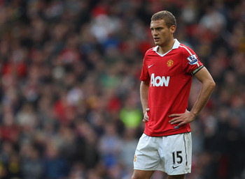 MANCHESTER, ENGLAND - OCTOBER 16:  Nemanja Vidic of Manchester United looks dejected during the Barclays Premier League match between Manchester United and West Bromwich Albion at Old Trafford on October 16, 2010 in Manchester, England.  (Photo by Alex Li