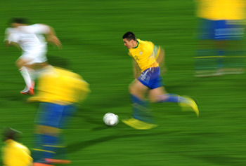 JOHANNESBURG, SOUTH AFRICA - JUNE 28:  Lucio of Brazil runs with the ball during the 2010 FIFA World Cup South Africa Round of Sixteen match between Brazil and Chile at Ellis Park Stadium on June 28, 2010 in Johannesburg, South Africa.  (Photo by Clive Ma