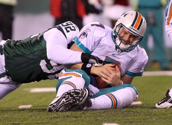 EAST RUTHERFORD, NJ - DECEMBER 12:  Chad Henne #7 of the Miami Dolphins is sacked by Shaun Ellis #92 of the New York Jets at New Meadowlands Stadium on December 12, 2010 in East Rutherford, New Jersey.  (Photo by Nick Laham/Getty Images)