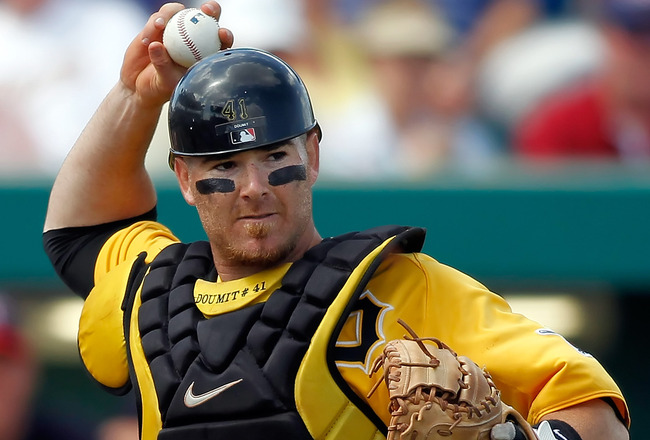 BRADENTON, FL - MARCH 02:  Catcher Ryan Doumit #41 of the Pittsburgh Pirates  throws over to first for an out against the Minnesota Twins during a Grapefruit League Spring Training Game at McKechnie Field on March 2, 2011 in Bradenton, Florida.  (Photo by