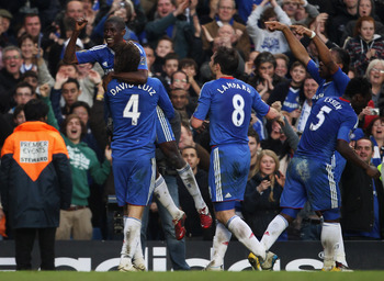LONDON, ENGLAND - MARCH 20:  Ramires of Chelsea is lifted by David Luiz in celebration as he scores their second goal during the Barclays Premier League match between Chelsea and Manchester City at Stamford Bridge on March 20, 2011 in London, England.  (P