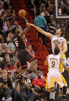 MIAMI, FL - MARCH 10:  LeBron James #6 of the Miami Heat shoots over Pau Gasol #16 of  the Los Angeles Lakers  during a game at American Airlines Arena on March 10, 2011 in Miami, Florida. NOTE TO USER: User expressly acknowledges and agrees that, by down