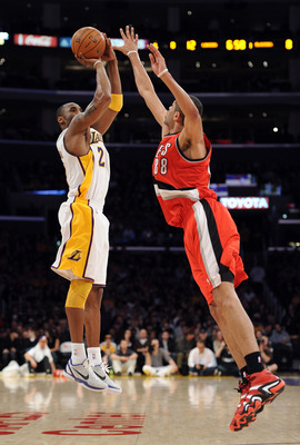 LOS ANGELES, CA - MARCH 20:  Kobe Bryant #24 of the Los Angeles Lakers shoots a jumper over Nicolas Batum #88 of the Portland Trail Blazers at the Staples Center on March 20, 2011 in Los Angeles, California.  NOTE TO USER: User expressly acknowledges and