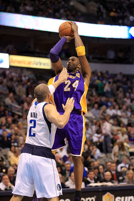 DALLAS, TX - MARCH 12:  Guard Kobe Bryant #24 of the Los Angeles Lakers takes a shot against Jason Kidd #2 of the Dallas Mavericks at American Airlines Center on March 12, 2011 in Dallas, Texas.  NOTE TO USER: User expressly acknowledges and agrees that,